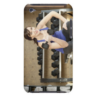 An active female lifting weights in a private Case-Mate iPod touch case