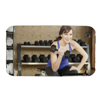 An active female lifting weights in a private iPhone 3 case