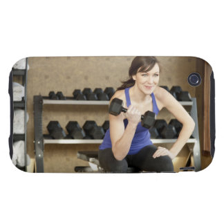 An active female lifting weights in a private tough iPhone 3 covers