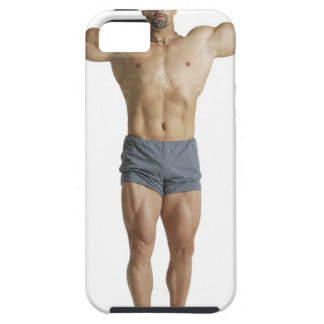an adult caucasian male bodybuilder holds his iPhone SE/5/5s case