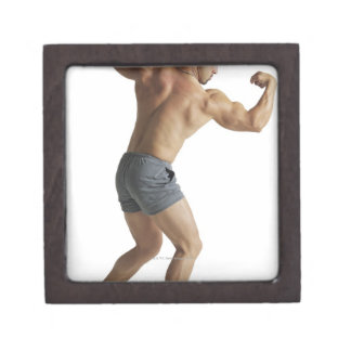 an adult caucasian male bodybuilder shows off jewelry box