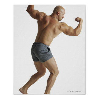 an adult caucasian male bodybuilder shows off print