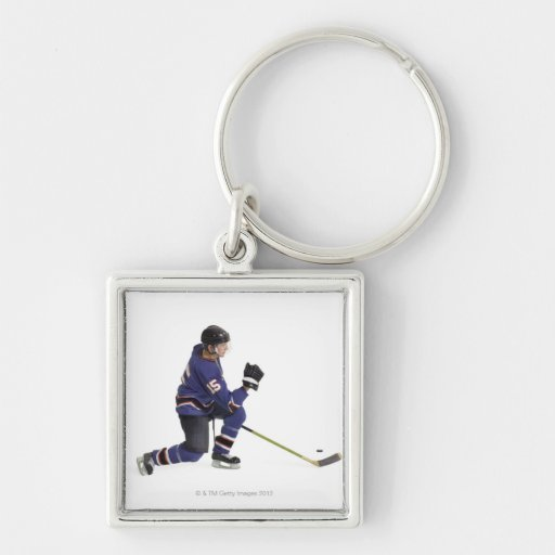 an adult caucasian male hockey player in a blue keychain