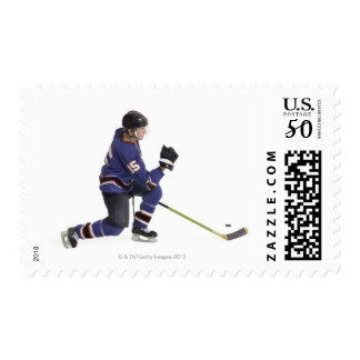 an adult caucasian male hockey player in a blue postage