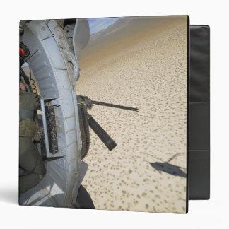 An aerial gunner scans terrain binder