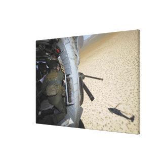 An aerial gunner scans terrain canvas print