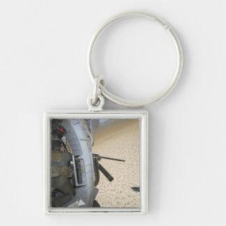 An aerial gunner scans terrain key chain