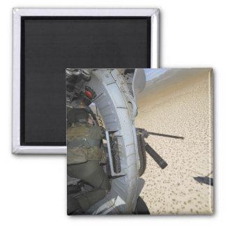 An aerial gunner scans terrain magnet