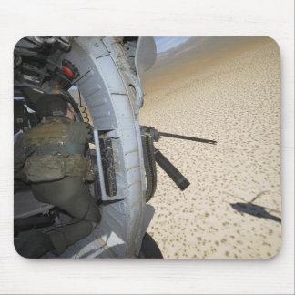 An aerial gunner scans terrain mouse pad
