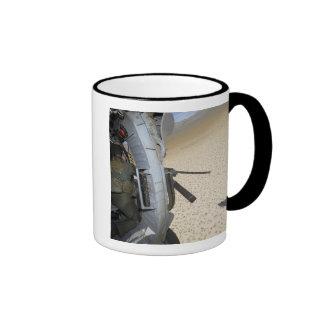 An aerial gunner scans terrain coffee mug