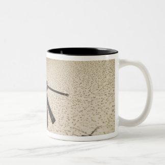An aerial gunner scans terrain Two-Tone coffee mug