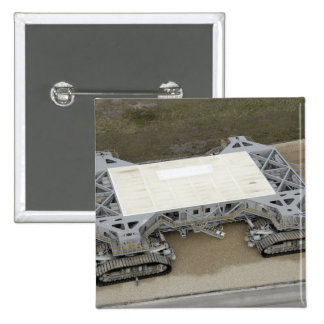 An aerial view of the crawler-transporter pinback button
