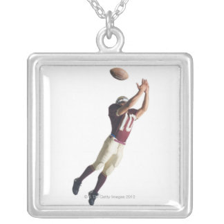 an african american football player in a red and personalized necklace