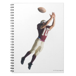 an african american football player in a red and notebook