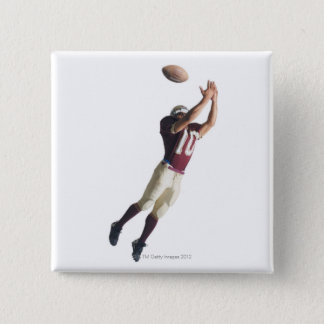 an african american football player in a red and pinback button
