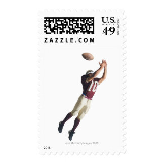 an african american football player in a red and stamps