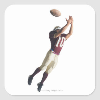 an african american football player in a red and square sticker