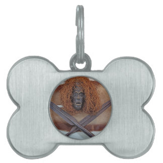An African mask with a spear on an antelope coat. Pet Name Tag