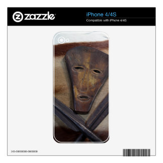 An African mask with a spear on an antelope skin. Decal For The iPhone 4S
