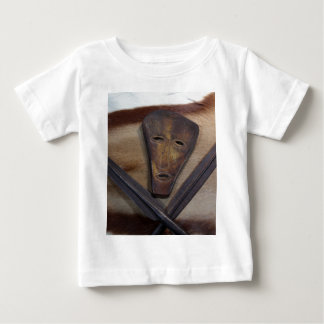 An African mask with a spear on an antelope skin. Baby T-Shirt