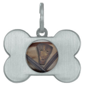 An African mask with a spear on an antelope skin. Pet ID Tag