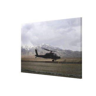 An AH-64A Apache taking off Canvas Print