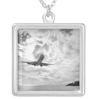 An airliner comes in for a landing at Princess Square Pendant Necklace