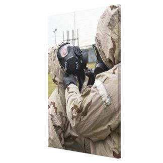 An Airman assists his wingman Canvas Print