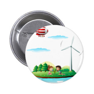An airship above an island with a windmill 2 inch round button