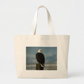 an american bald eagle on a pole large tote bag