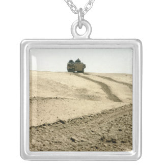 An amphibious assault vehicle silver plated necklace