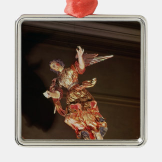 An angel above the altarpiece metal ornament