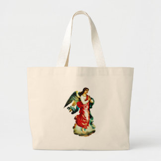 An angel in red color dress praying tote bags