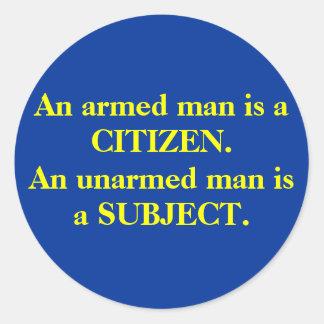 An armed man is a CITIZEN. An unarmed man is a ... Classic Round Sticker