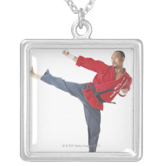an asian male karate black belt wearing a red personalized necklace