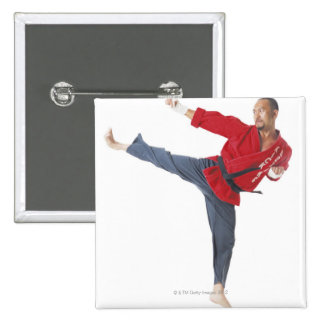 an asian male karate black belt wearing a red pinback button