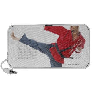an asian male karate black belt wearing a red mp3 speakers