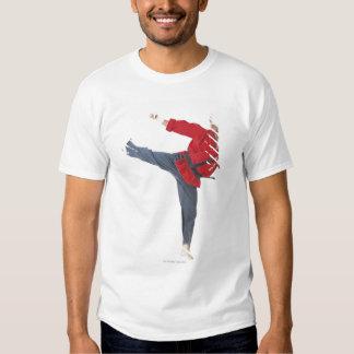 an asian male karate black belt wearing a red tee shirt
