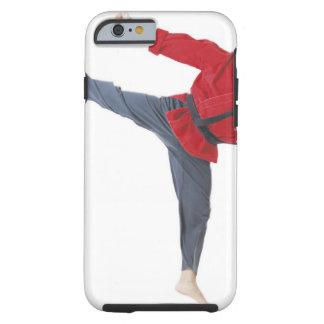 an asian male karate black belt wearing a red tough iPhone 6 case