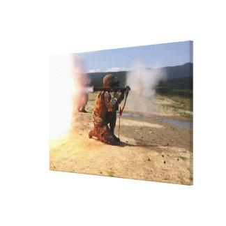 An assaultman fires a Rocket Propelled Grenade Canvas Print