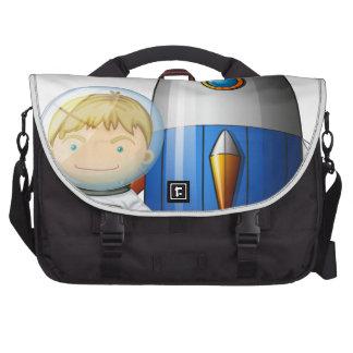 An astronaut beside the airship laptop commuter bag