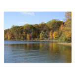 an autumn scene of colorful trees by a lake post cards