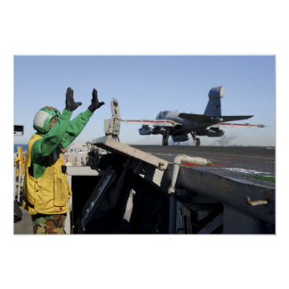 An EA-6B Prowler launches from the flight deck Poster