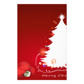 An elf beside the christmas tree stationery