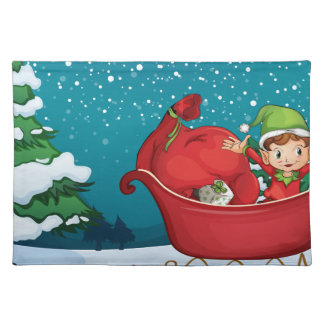 An elf riding on a sleigh with a sack of gifts cloth placemat