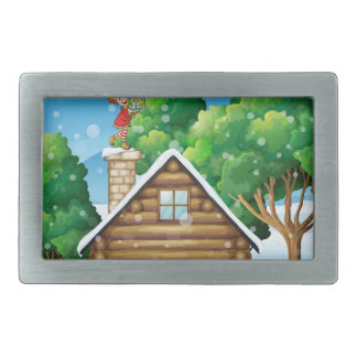 An elf with a gift standing above the house rectangular belt buckle