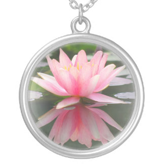 An Enchanting Water Lily in a Pond Round Pendant Necklace
