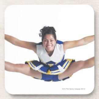 an ethnic teenage female cheerleader jumps high beverage coaster