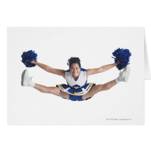 an ethnic teenage female cheerleader jumps high greeting card