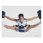 an ethnic teenage female cheerleader jumps high poster